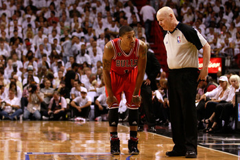 MIAMI, FL - MAY 24:  Derrick Rose #1 of the Chicago Bulls talks with referee Joey Crawford against the Miami Heat in Game Four of the Eastern Conference Finals during the 2011 NBA Playoffs on May 24, 2011 at American Airlines Arena in Miami, Florida. NOTE