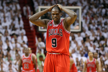 MIAMI, FL - MAY 22:  Luol Deng #9 of the Chicago Bulls walks up court with his head down against the Miami Heat in Game Three of the Eastern Conference Finals during the 2011 NBA Playoffs on May 22, 2011 at American Airlines Arena in Miami, Florida.  NOTE