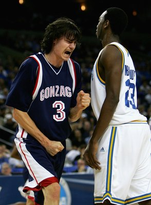 OAKLAND, CA - MARCH 23:  Adam Morrison #3 of the Gonzaga Bulldogs celebrates a basket and a foul call against the UCLA Bruins during the third round game of the NCAA Division I Men's Basketball Tournament at the Arena in Oakland on March 23, 2006 in Oakla