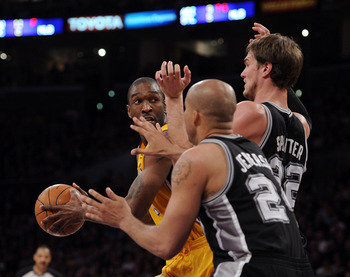 LOS ANGELES, CA - APRIL 12:  Joe Smith #1 of the Los Angeles Lakers grabs a rebound in front of Tiago Splitter #22 and Richard Jefferson #24 of the San Antonio Spurs at Staples Center on April 12, 2011 in Los Angeles, California.  NOTE TO USER: User expre