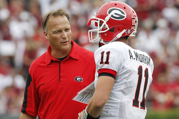 COLUMBIA, SC - SEPTEMBER 11: Head coach Mark Richt of the Georgia Bulldogs speaks with quarterback Aaron Murray #11 during the game against the South Carolina Gamecocks at Williams-Brice Stadium on September 11, 2010 in Columbia, South Carolina. The Gamec