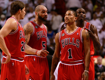 MIAMI, FL - MAY 24: (L-R) Kyle Korver #26, Carlos Boozer #5, Derrick Rose #1 and Luol Deng #9 of the Chicago Bulls look on against the Miami Heat in Game Four of the Eastern Conference Finals during the 2011 NBA Playoffs on May 24, 2011 at American Airlin