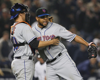 NEW YORK - MAY 20:  Francisco Rodriguez #75 of the New York Mets celebrates with teamate Josh Thole #30 after defetaing the New York Yankees 2-1 on May 20, 2011 at Yankee Stadium in the Bronx borough of New York City.  (Photo by Mike Stobe/Getty Images)