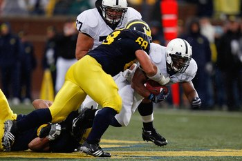 ANN ARBOR, MI - OCTOBER 24:  Mike Martin #68 of the Michigan Wolverines tackles Brandon Beachum #3 of the Penn State Nittany Lions on October 24, 2009 at Michigan Stadium in Ann Arbor, Michigan. (Photo by  Gregory Shamus/Getty Images)
