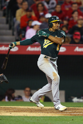 ANAHEIM, CA - MAY 23:  Coco Crisp #4 of the Oakland Athletics singles in the seventh inning on a line drive to right field during the game against the Los Angeles Angels of Anaheim at Angel Stadium on May 23, 2011 in Anaheim, California.  (Photo by Joe Sc