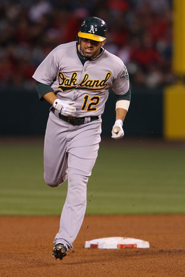 ANAHEIM, CA - MAY 24:  David DeJesus #12 of the Oakland Athletics runs the bases after a home run hit in the fourth inning during the game against the Los Angeles Angels of Anaheim at Angel Stadium on May 24, 2011 in Anaheim, California.  (Photo by Joe Sc