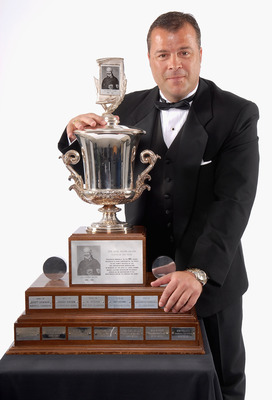 TORONTO, ON - JUNE 14:  Head coach Alain Vigneault  of the Vancouver Canucks poses with the Jack Adams Award for Coach of the Year during the 2007 NHL Awards at the Elgin Theatre on June 14, 2007 in Toronto, Ontario.  (Photo by Graig Abel/Getty Images for