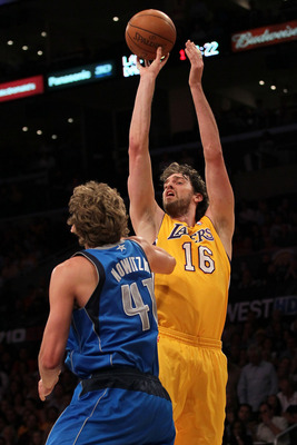 LOS ANGELES, CA - MAY 04:  Pau Gasol #16 of the Los Angeles Lakers goes up for a shot against Dirk Nowitzki #41 of the Dallas Mavericks in the first quarter in Game Two of the Western Conference Semifinals in the 2011 NBA Playoffs at Staples Center on May