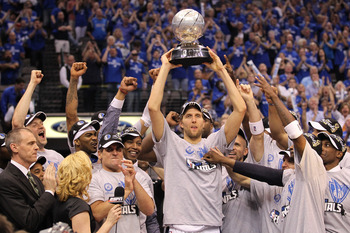 DALLAS, TX - MAY 25:  Dirk Nowitzki #41 and the Dallas Mavericks celebrate their 100-96 victory against the Oklahoma City Thunder in Game Five of the Western Conference Finals during the 2011 NBA Playoffs at American Airlines Center on May 25, 2011 in Dal