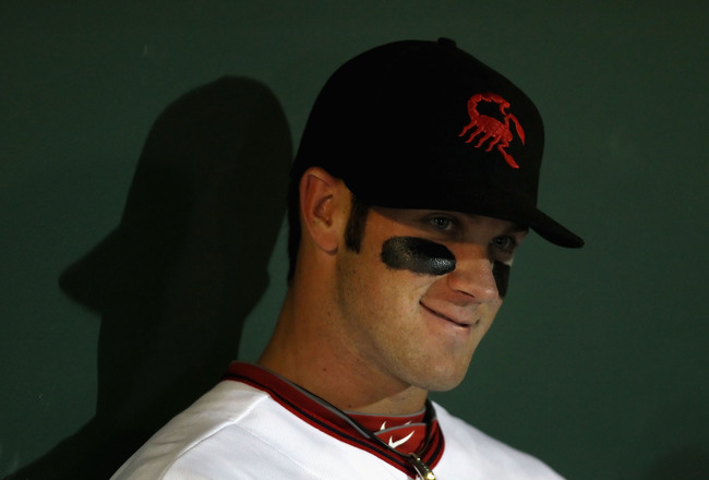 SCOTTSDALE, AZ - OCTOBER 20:  Washington Nationals prospect, Bryce Harper #34 playing for the Scottsdale Scorpions sits in the dugout during the AZ Fall League game against the Mesa Solar Sox at Scottsdale Stadium on October 20, 2010 in Scottsdale, Arizon