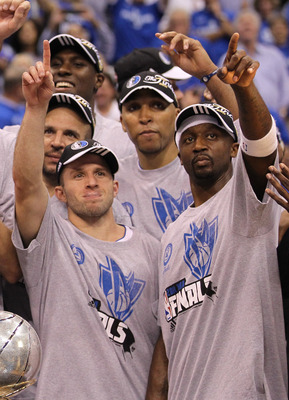 DALLAS, TX - MAY 25:  Jason Kidd #2, Jose Juan Barea #11, Shawn Marion #0 and Jason Terry #31 and the Dallas Mavericks celebrate their 100-96 victory against the Oklahoma City Thunder in Game Five of the Western Conference Finals during the 2011 NBA Playo