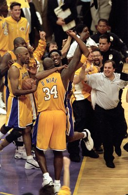 19 Jun 2000:  Kobe Bryant #8 and Shaquille O''Neal #34 of the Los Angeles Lakers celebrate after winning the NBA Finals Game 6 against the Indiana Pacers at the Staples Center in Los Angeles, California.  The Lakers defeated the Pacers in 116-111.  NOTE T