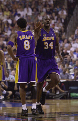 13 Jun 2001:  Shaquille O''Neal of the Los Angeles Lakers receives a high-five from teammate Kobe Bryant #8 during Game 4 of the NBA Finals against the Philadelphia 76ers at the First Union Center in Philadelphia, Pennsylvania.   DIGITAL IMAGE Mandatory C