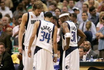 DALLAS - JUNE 20:  Owner Mark Cuban and Darrell Armstrong #10 of the Dallas Mavericks watch the final moments of the Mavericks loss to the Miami Heat in game six of the 2006 NBA Finals on June 20, 2006 at American Airlines Center in Dallas, Texas.  The He