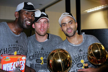 CLEVELAND - JUNE 14:  Tony Parker #9 and Head Coach Gregg Popovich of the San Antonio Spurs celebrates after the win in Game Four of the NBA Finals on June 14, 2007 at the Quicken Loans Arena in Cleveland, Ohio. NOTE TO USER: User expressly acknowledges a