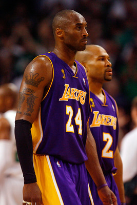 BOSTON - JUNE 17:  Kobe Bryant #24 and Derek Fisher #2 of the Los Angeles Lakers walk to the bench as the Lakers trail the Boston Celtics in Game Six of the 2008 NBA Finals on June 17, 2008 at TD Banknorth Garden in Boston, Massachusetts. NOTE TO USER: Us