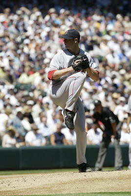 SEATTLE - JULY 23:  Jon Lester #62 of the Boston Red Sox pitches against the Seattle Mariners on July 23, 2006 at Safeco Field in Seattle, Washington. The Mariners defeated the Red Sox 9-8. (Photo by Otto Greule Jr/Getty Images)