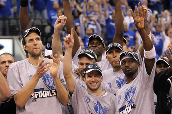 DALLAS, TX - MAY 25:  Dirk Nowitzki #41, Jason Terry #31 and the Dallas Mavericks celebrate their 100-96 victory against the Oklahoma City Thunder in Game Five of the Western Conference Finals during the 2011 NBA Playoffs at American Airlines Center on Ma