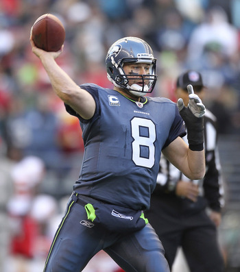 SEATTLE - NOVEMBER 28:  Quarterback Matt Hasselbeck #8 of the Seattle Seahawks throws a touchdown pass to Chris Baker in the third quarter against the Kansas City Chiefs at Qwest Field on November 28, 2010 in Seattle, Washington. The Chiefs defeated the S
