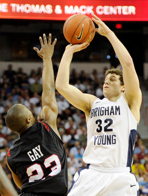 LAS VEGAS, NV - MARCH 12:  Jimmer Fredette #32 of the Brigham Young University Cougars shoots against D.J. Gay #23 of the San Diego State Aztecs during the championship game of the Conoco Mountain West Conference Basketball tournament at the Thomas & Mack