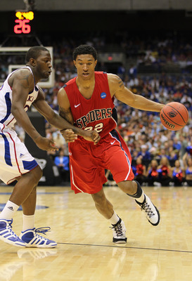 SAN ANTONIO, TX - MARCH 25:  Justin Harper #32 of the Richmond Spiders drives against the Kansas Jayhawks during the southwest regional of the 2011 NCAA men's basketball tournament at the Alamodome on March 25, 2011 in San Antonio, Texas. Kansas defeated