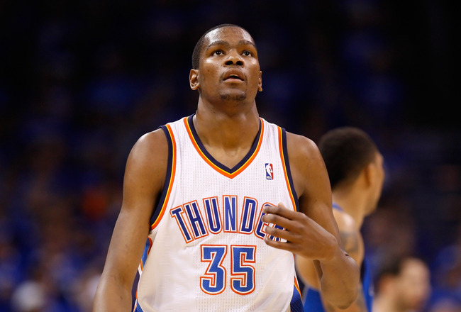 OKLAHOMA CITY, OK - MAY 23:  Kevin Durant #35 of the Oklahoma City Thunder looks on in the third quarter while taking on the Dallas Mavericks in Game Four of the Western Conference Finals during the 2011 NBA Playoffs at Oklahoma City Arena on May 23, 2011