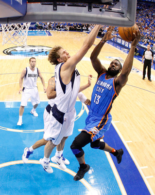 DALLAS, TX - MAY 25:  James Harden #13 of the Oklahoma City Thunder goes up for a layup against Dirk Nowitzki #41 of the Dallas Mavericks in the first half in Game Five of the Western Conference Finals during the 2011 NBA Playoffs at American Airlines Cen
