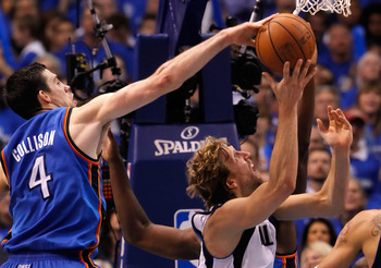 DALLAS, TX - MAY 25:  Nick Collison #4 of the Oklahoma City Thunder attempts to block the shot of Dirk Nowitzki #41 of the Dallas Mavericks in the first half in Game Five of the Western Conference Finals during the 2011 NBA Playoffs at American Airlines C