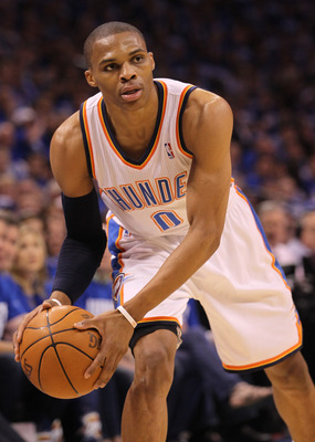 OKLAHOMA CITY, OK - MAY 21:  Russell Westbrook #0 of the Oklahoma City Thunder looks to pass the ball while taking on the Dallas Mavericks in Game Three of the Western Conference Finals during the 2011 NBA Playoffs at Oklahoma City Arena on May 21, 2011 i