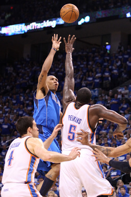 OKLAHOMA CITY, OK - MAY 21:  Shawn Marion #0 of the Dallas Mavericks shoots the ball over Kendrick Perkins #5 of the Oklahoma City Thunder in the first quarter in Game Three of the Western Conference Finals during the 2011 NBA Playoffs at Oklahoma City Ar