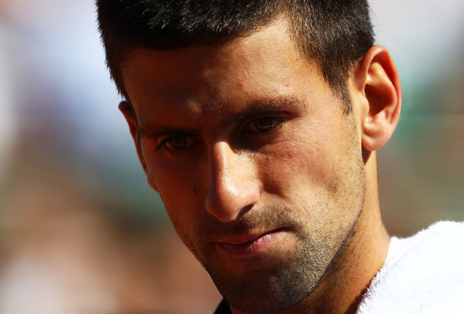 PARIS, FRANCE - MAY 25:  Novak Djokovic of Serbia looks on during the men's singles round two match between Victor Hanescu of Romania and Novak Djokovic of Serbia on day four of the French Open at Roland Garros on May 25, 2011 in Paris, France.  (Photo by