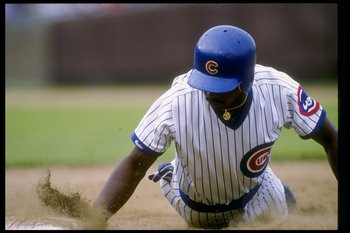 Jerome Walton of the Chicago Cubs slides into a base during a game.