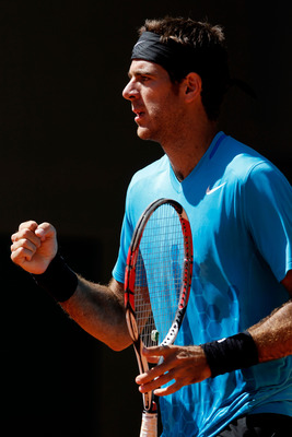 PARIS, FRANCE - MAY 25:  Juan Martin Del Potro of Argentina celebrates a point during the men's singles round two match between Juan Martin Del Potro of Argentina and Blaz Kavcic Slovenia on day four of the French Open at Roland Garros on May 25, 2011 in