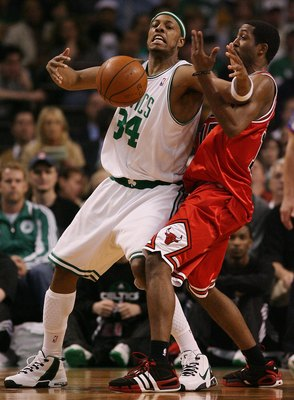 BOSTON - MAY 02:  Paul Pierce #34 of the Boston Celtics tries to hang on to the ball as John Salmons #15 of the Chicago Bulls defends in Game Seven of the Eastern Conference Quarterfinals during the 2009 NBA Playoffs at TD Banknorth Garden on May 2, 2009