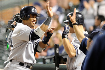 BALTIMORE, MD - MAY 18:  Robinson Cano #24 of the New York Yankees celebrates with teammates after scoring in the fifteenth inning against the Baltimore Orioles at Oriole Park at Camden Yards on May 18, 2011 in Baltimore, Maryland. New York won the game 4