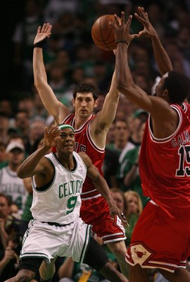 BOSTON - MAY 02:  Rajon Rondo #9 of the Boston Celtics loses the ball as Kirk Hinrich #12 of the Chicago Bulls defends in Game Seven of the Eastern Conference Quarterfinals during the 2009 NBA Playoffs at TD Banknorth Garden on May 2, 2009 in Boston, Mass