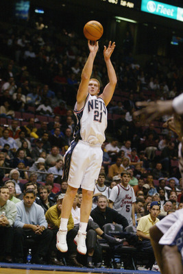 EAST RUTHERFORD, NJ - NOVEMBER 15:  Brian Scalabrine #21 of the New Jersey Nets shoots against the Houston Rockets during the game on November 15, 2004 at the Continental Airlines Arena in East Rutherford, New Jersey.  The Rockets won 80-69.  NOTE TO USER