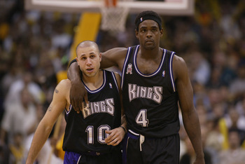 LOS ANGELES - MAY 31:  Chris Webber #4  walks upcourt with Mike Bibby #10 of the Sacramento Kings in Game six of the Western Conference Finals against the Los Angeles Lakers during the 2002 NBA Playoffs on May 31, 2002 at Staples Center in Los Angeles, Ca