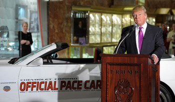 NEW YORK, NY - APRIL 05:  Donald Trump checks out his new ride as the 2011 Indianapolis 500 Chevrolet Camaro SS Convertible Pace Car driver for the 100th Anniversary of the Indianapolis 500 at Trump Tower on April 5, 2011 in New York City. Trump will lead