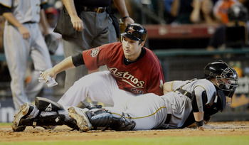 HOUSTON - AUGUST 15:  Brett Wallace #29 of the Houston Astros slides safely into home plate as catcher Chris Snyder #19 of the Pittsburgh Pirates looks around at Minute Maid Park on August 15, 2010 in Houston, Texas.  (Photo by Bob Levey/Getty Images)