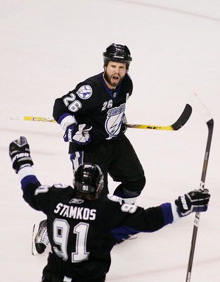 TAMPA, FL - MAY 25:  Martin St. Louis #26 celebrates his second period goal with Steven Stamkos #91 of the Tampa Bay Lightning in Game Six of the Eastern Conference Finals against the Boston Bruins during the 2011 NHL Stanley Cup Playoffs at St Pete Times