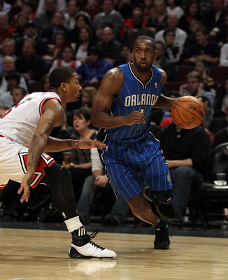 CHICAGO, IL - JANUARY 28: Gilbert Arenas #1 of the Orlando Magic moves against Derrick Rose #1 of the Chicago Bulls at the United Center on January 28, 2011 in Chicago, Illinois. The Bulls defeated the Magic 99-90. NOTE TO USER: User expressly acknowledge