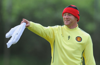 MANCHESTER, ENGLAND - MAY 24:  Wayne Rooney of Manchester United looks on during the Manchester United training session ahead of the UEFA Champions League Final against Barcelona at the Carrington Training Ground on May 24, 2011 in Manchester, England.  (