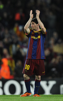 BARCELONA, SPAIN - MAY 03:  Lionel Messi of FC Barcelona celebrates after defeating Real Madrid at the end of the UEFA Champions League Semi Final second leg match between Barcelona and Real Madrid at the Camp Nou on May 3, 2011 in Barcelona, Spain.  (Pho