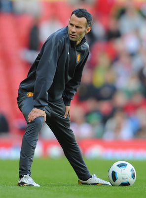MANCHESTER, ENGLAND - MAY 24: Ryan Giggs of Manchester United warms up during the Gary Neville Testimonial Match between Manchester United and Juventus at Old Trafford on May 24, 2011 in Manchester, England.  (Photo by Michael Regan/Getty Images)