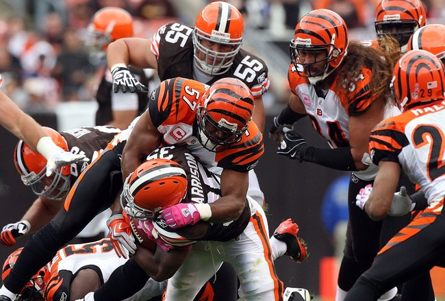 CLEVELAND - OCTOBER 04:  Dhani Jones #57 of the Cincinnati Bengals makes a tackle against the Cleveland Browns during their game at Cleveland Browns Stadium on October 4, 2009 in Cleveland, Ohio. The Bengals defeated the Browns 23-20 in overtime.  (Photo