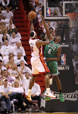 MIAMI, FL - MAY 11: LeBron James #6 of the Miami Heat shoots over Jeff Green #8 of the Boston Celtics during Game Five of the Eastern Conference Semifinals of the 2011 NBA Playoffs at American Airlines Arena on May 11, 2011 in Miami, Florida. NOTE TO USER