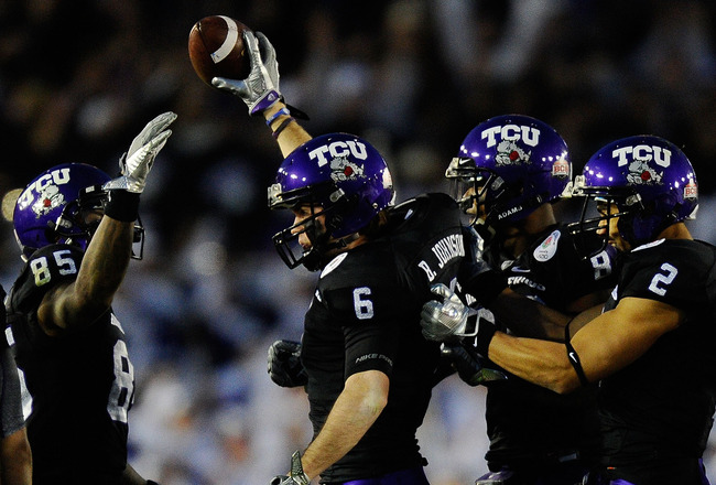 PASADENA, CA - JANUARY 01:  Wide receiver Bart Johnson #6 of the TCU Horned Frogs celebrates recovering an onside kick attempt by the Wisconsin Badgers in the 97th Rose Bowl game on January 1, 2011 in Pasadena, California.  (Photo by Kevork Djansezian/Get