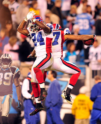 CHARLOTTE, NC - OCTOBER 25:  Terrence McGee #24 and George Wilson #37 of the Buffalo Bills celebrate after Wilson's fourth-quarter interception against the Carolina Panthers at Bank of America Stadium on October 25, 2009 in Charlotte, North Carolina. Buff