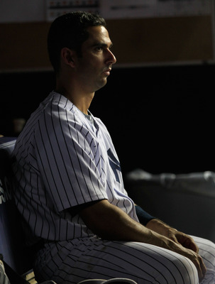 NEW YORK, NY - APRIL 25:  Jorge Posada #20 of the New York Yankees looks on from the dugout during the game against the Chicago White Sox at Yankee Stadium on April 25, 2011 in the Bronx borough of New York City.  (Photo by Chris Trotman/Getty Images)